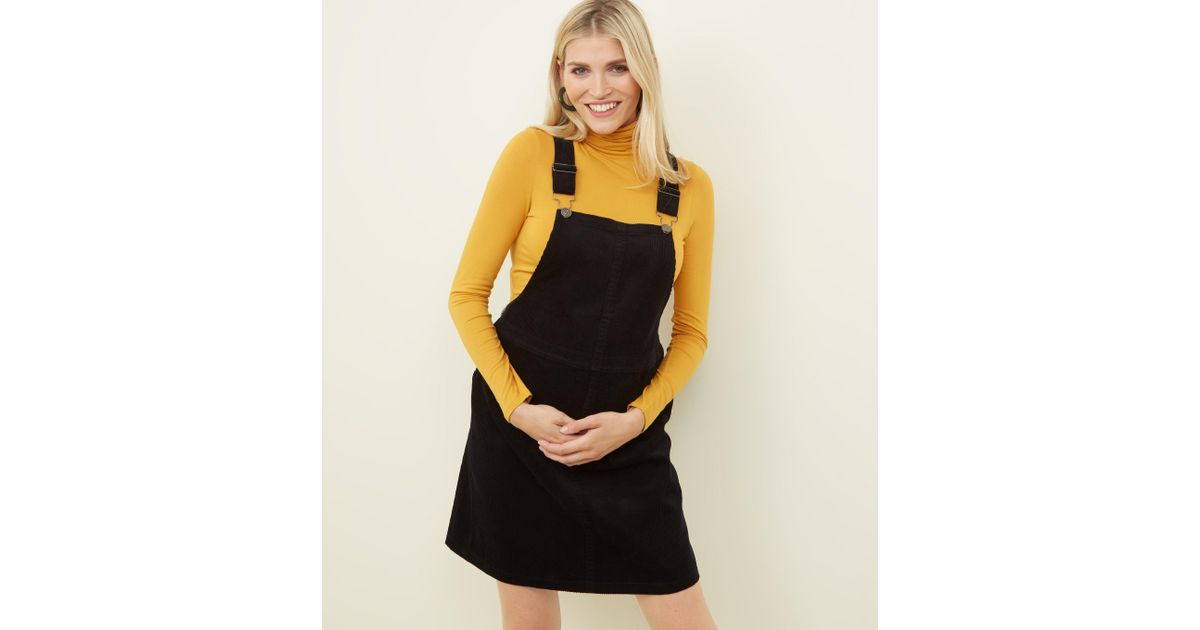 f85d752f7c1 New Look Maternity Black Front Pocket Buckle Pinafore Dress in Black - Lyst