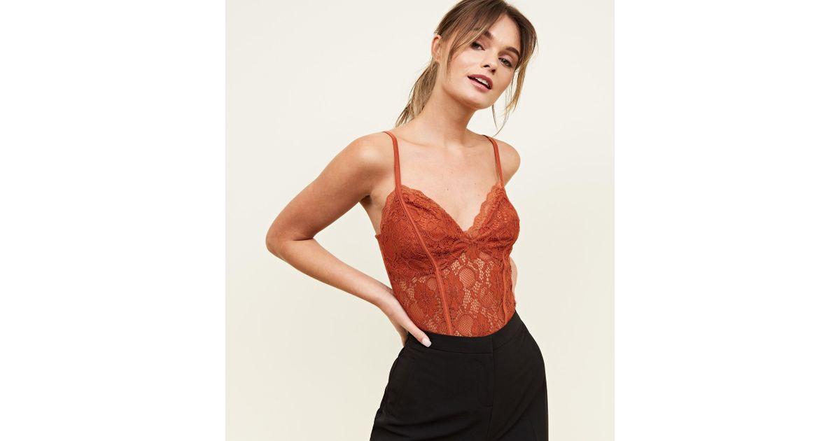 65d3d136ac63 New Look Rust Sweetheart Neck Lace Bodysuit - Lyst