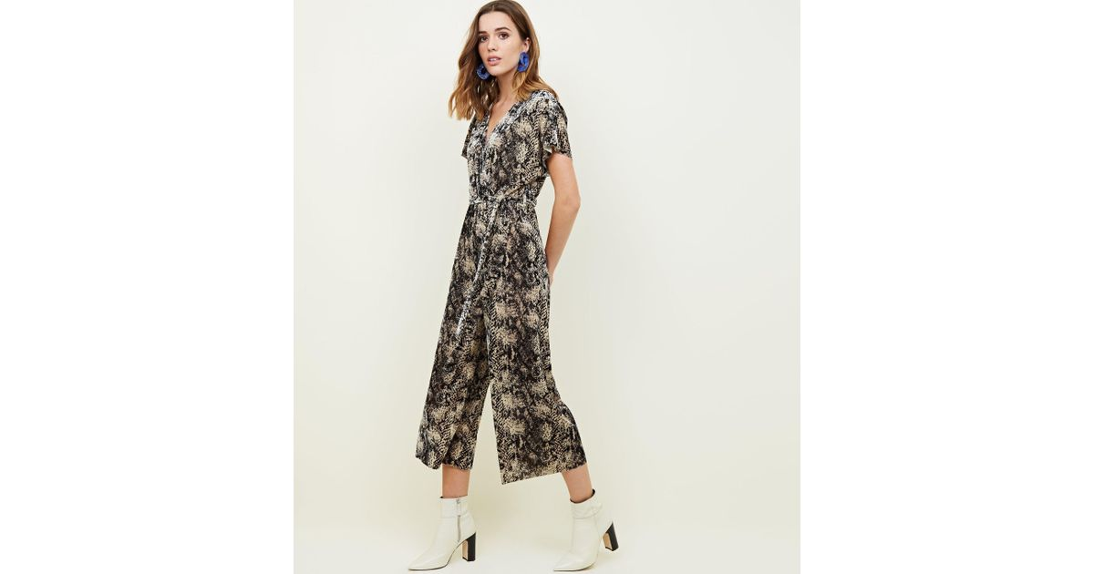 d4bc51ac7e1c New Look Petite Brown Velvet Snake Print Wrap Jumpsuit in Brown - Save 33%  - Lyst