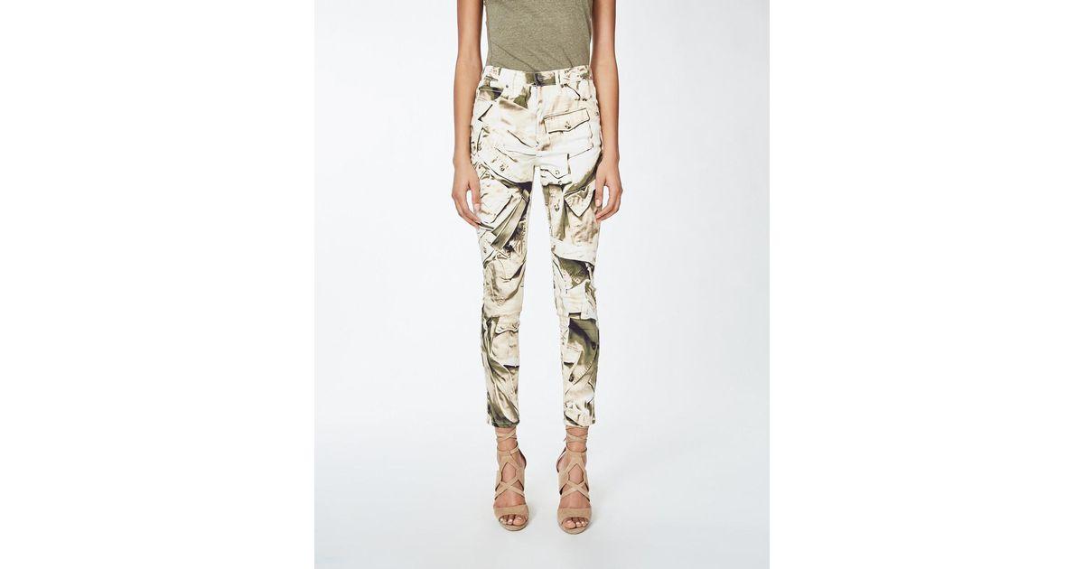 1965174ab3470 Nicole Miller Printed Skinny Pants in Natural - Lyst