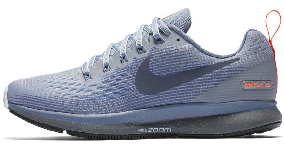 27c47ddcd6bb Lyst - Nike Air Zoom Pegasus 34 Shield Women s Running Shoe in Blue