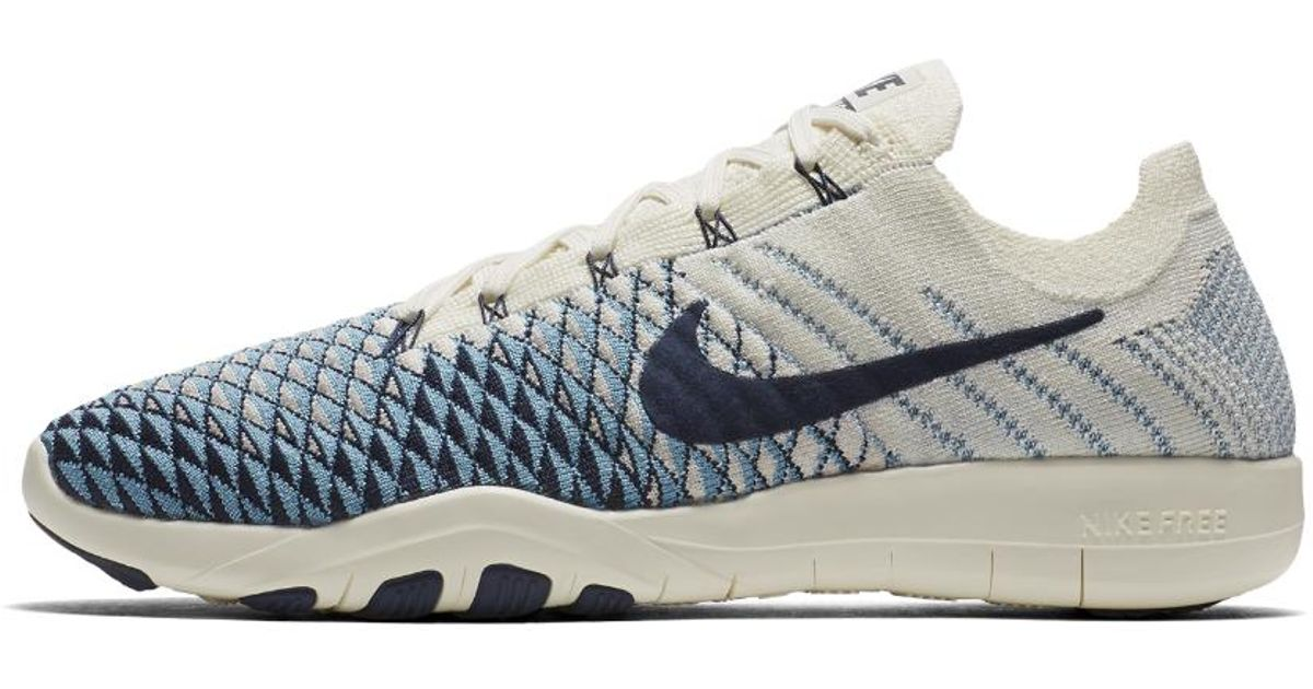 b697e06c57f2 ... where to buy lyst nike free tr flyknit 2 indigo womens training shoe in  blue a17bc