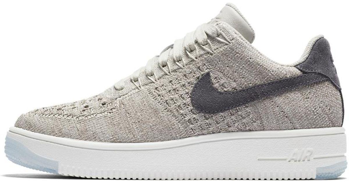 Lyst - Nike Air Force 1 Flyknit Low Women s Shoe in Gray f209ee2bba