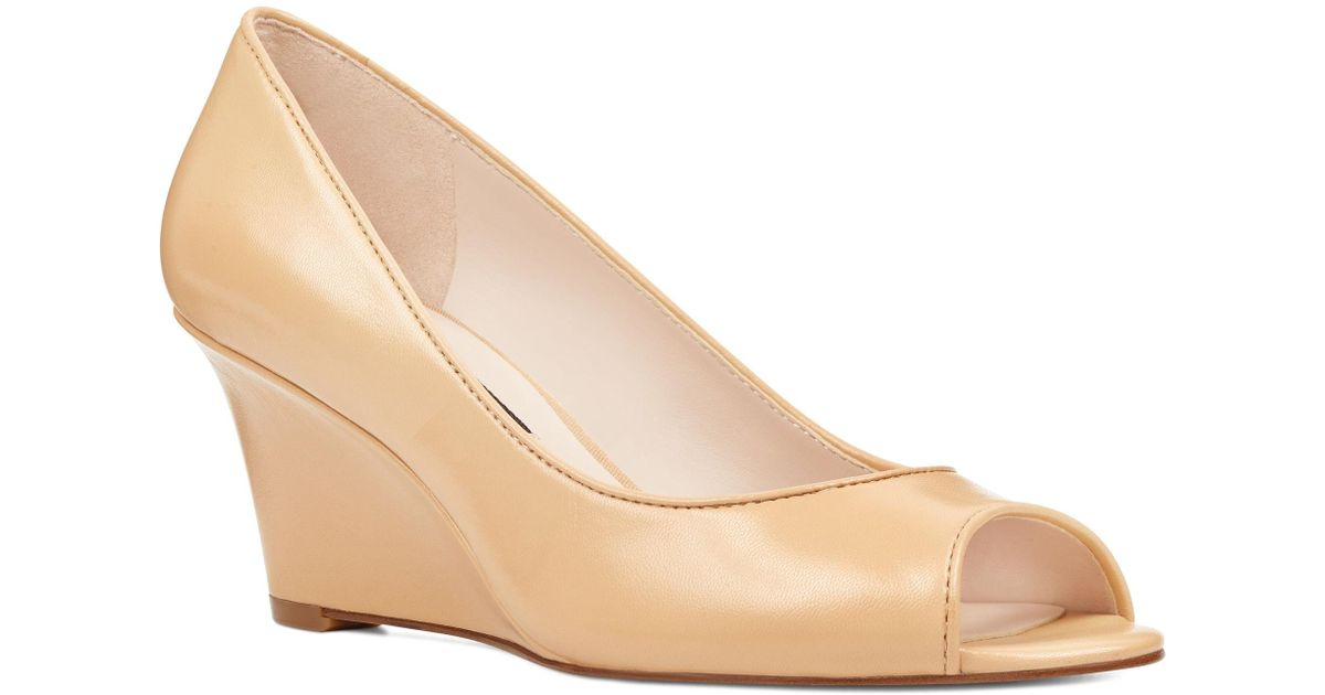 aec7379dddfd Lyst - Nine West Relaxxin Peep Toe Wedges in Natural