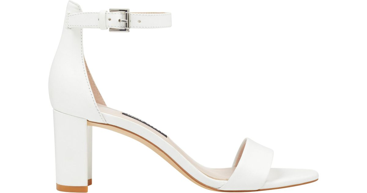 5e4c8b94542 Lyst - Nine West Pruce Ankle Strap Block Heel Sandals in White