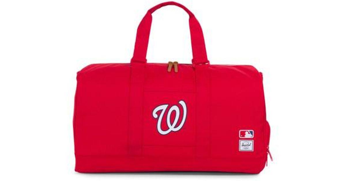 cf7b2cedfb Lyst - Herschel Supply Co. Novel - Mlb National League Duffel Bag in Red