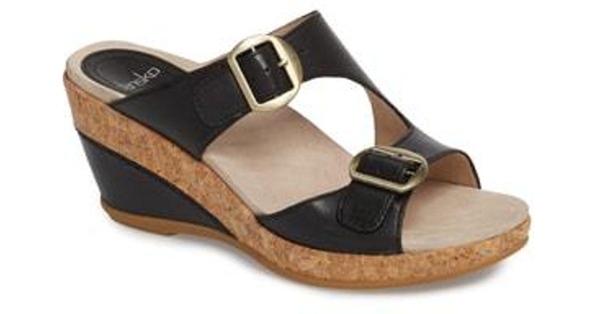 972ce0800c6 Lyst - Dansko Carla Wedge Slide Sandal in Black - Save 45%
