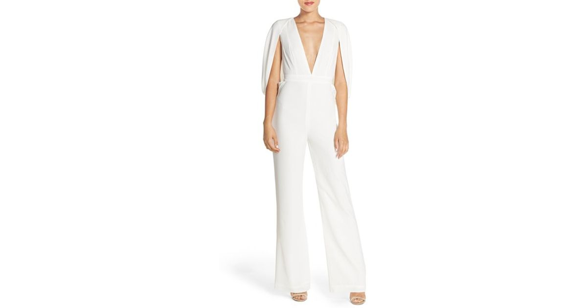 cc4be5c3ed Lyst - Misha Collection  olympia  Cape Sleeve Jumpsuit in White