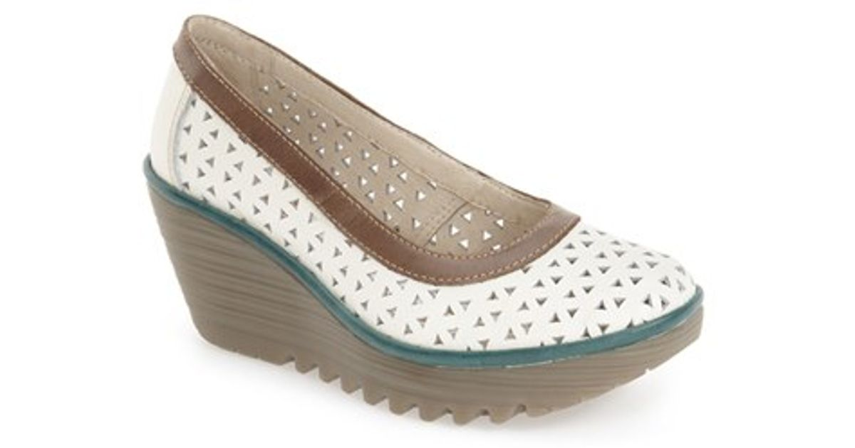20e5ae5569a Lyst - Fly London Yare Perforated Leather Wedge Pumps in White
