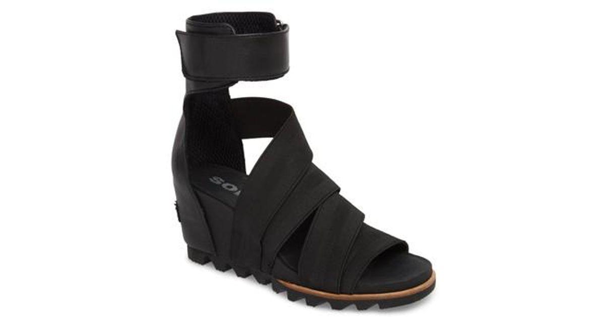 05a38a3f0d2 Lyst - Sorel Joanie Gladiator Ii Cuff Wedge Sandal in Black