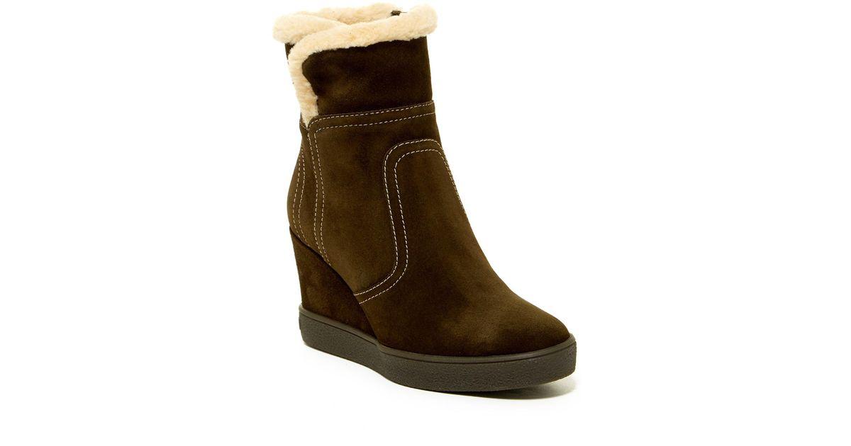 581511ff3697 Lyst - Aquatalia Cindy Faux Fur Wedge Boot in Brown