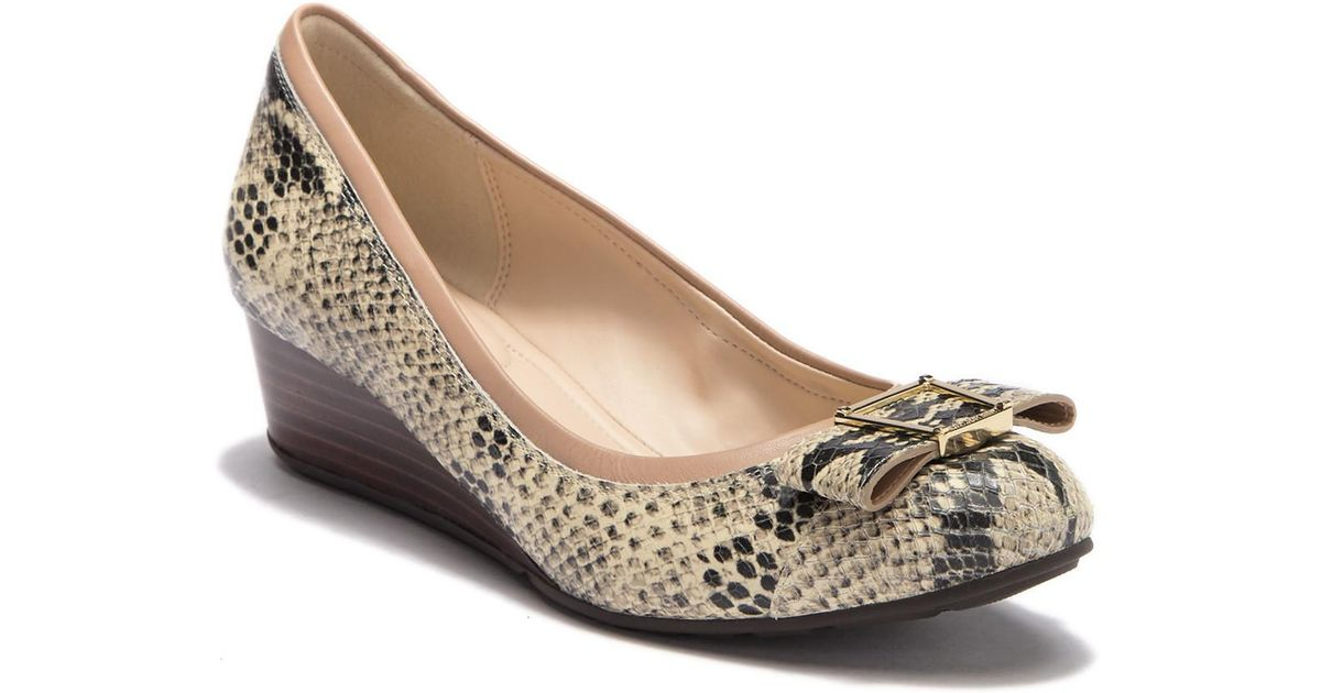 69df2459f3 Lyst - Cole Haan Emory Bow Snake-embossed Leather Wedge Pump