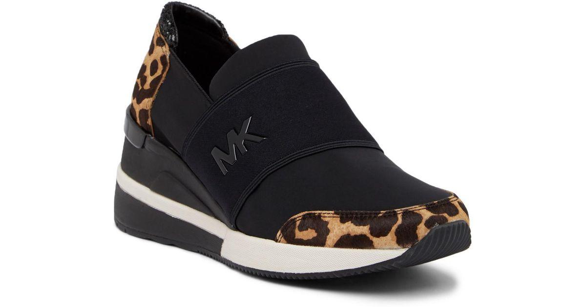 49a4b793dc9 Lyst - MICHAEL Michael Kors Felix Trainer Genuine Calf Hair Wedge Sneaker  in Black