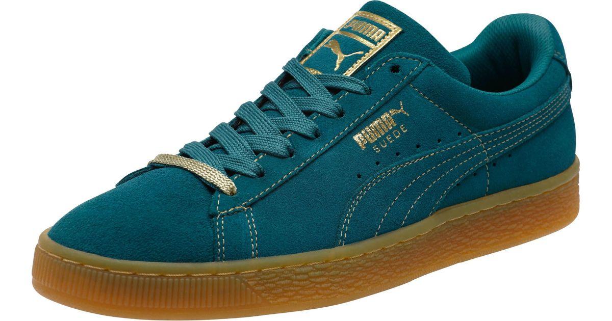 1a7668806399 Lyst - PUMA Suede Classic Gold Foil Men s Sneakers in Blue for Men