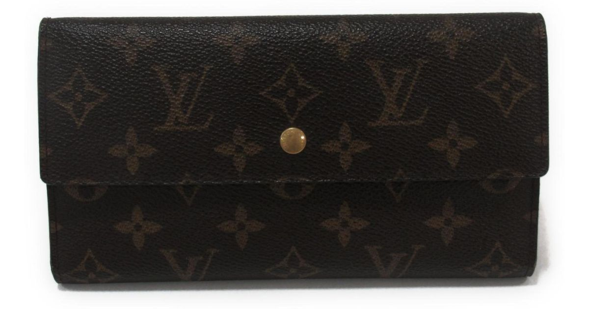 1223262a4eda Lyst - Louis Vuitton Portefeuille International Tri-fold Long Wallet  Monogram Canvas in Brown