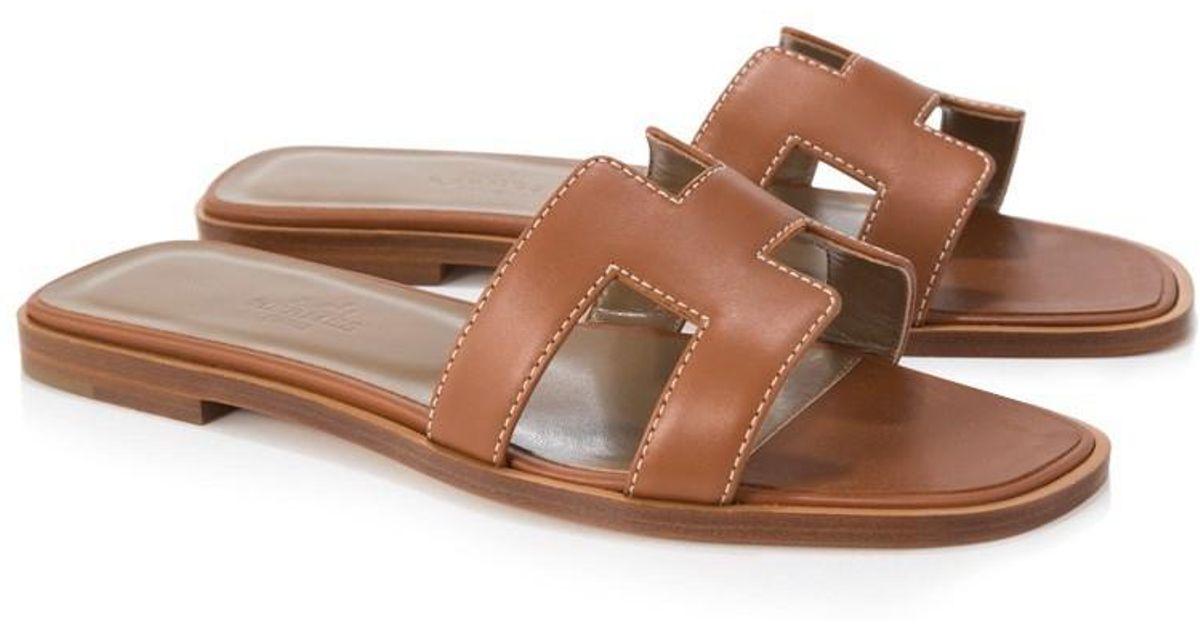 14e86ecffaa4c0 Lyst - Hermès Pre-owned Hermès Oran Sandals in Brown