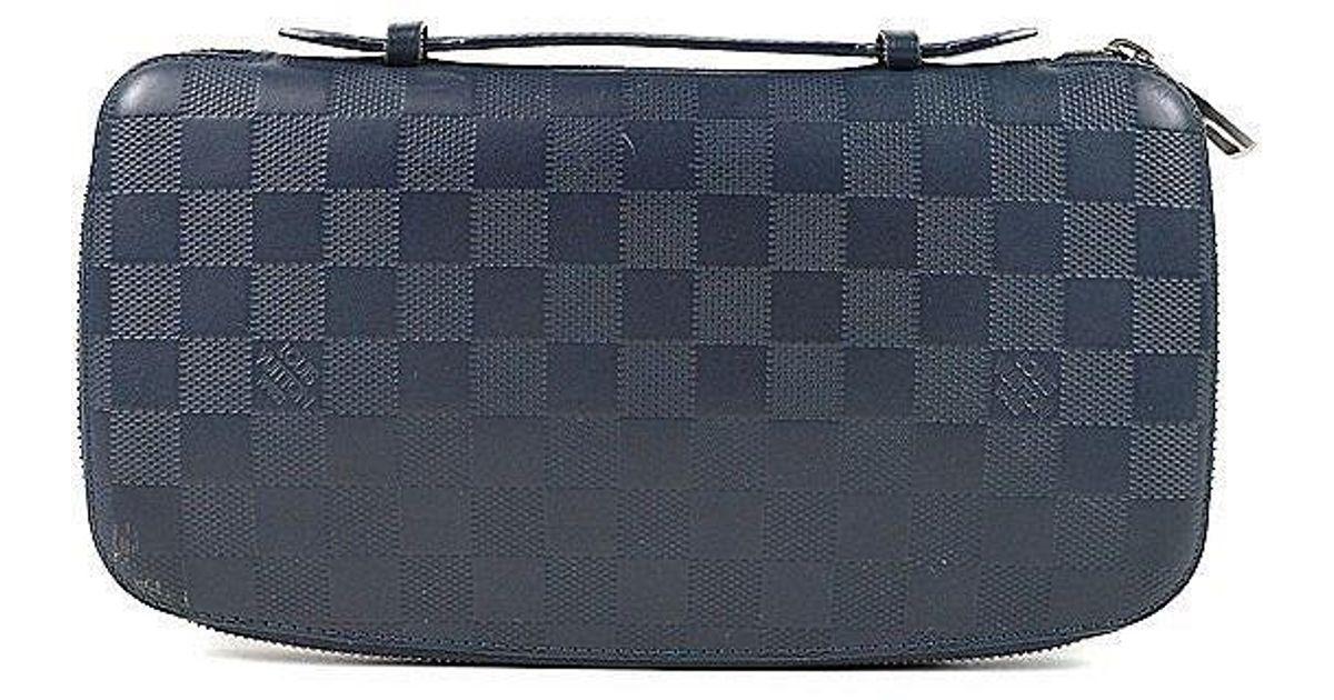 b7b7b70c8d0a Lyst - Louis Vuitton Organizer Atoll Travel Case Wallet Damier Infini in  Blue