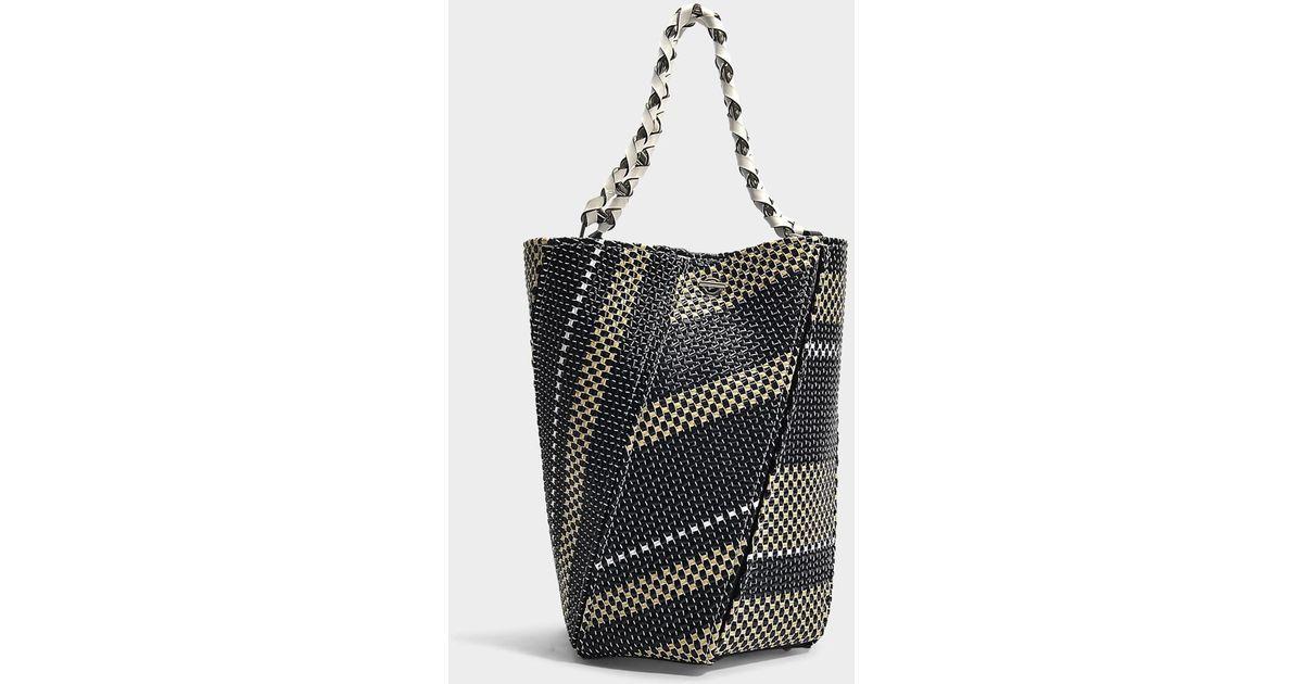 96f1bc374e0 proenza-schouler-Multicolor-Medium-Hex-Bucket-Bag -In-Black-And-White-Woven-Raffia.jpeg
