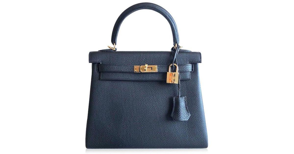 c8a3a6593bfc ... ireland lyst hermès hermès kelly 25 togo black ghdw in black 7c64c 741dc