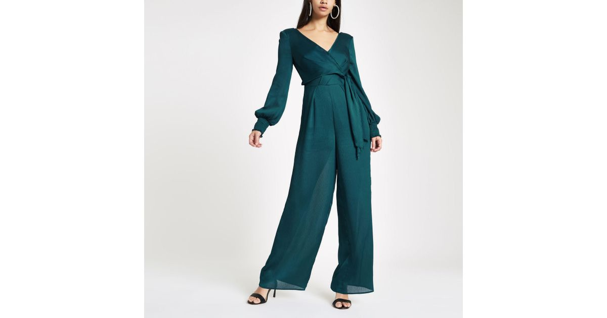 281064ac728 Lyst - River Island Turquoise Wrap Front Wide Leg Jumpsuit in Blue
