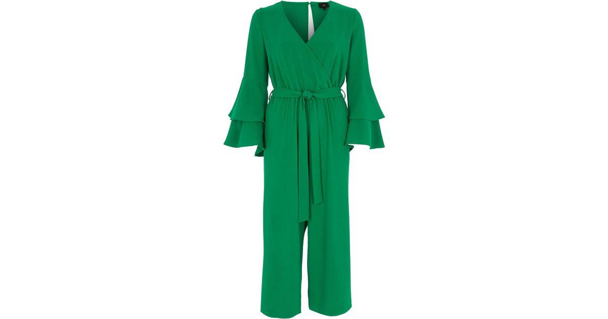 4130f6c4b228 Lyst - River Island Green Wrap Frill Sleeve Culotte Jumpsuit in Green