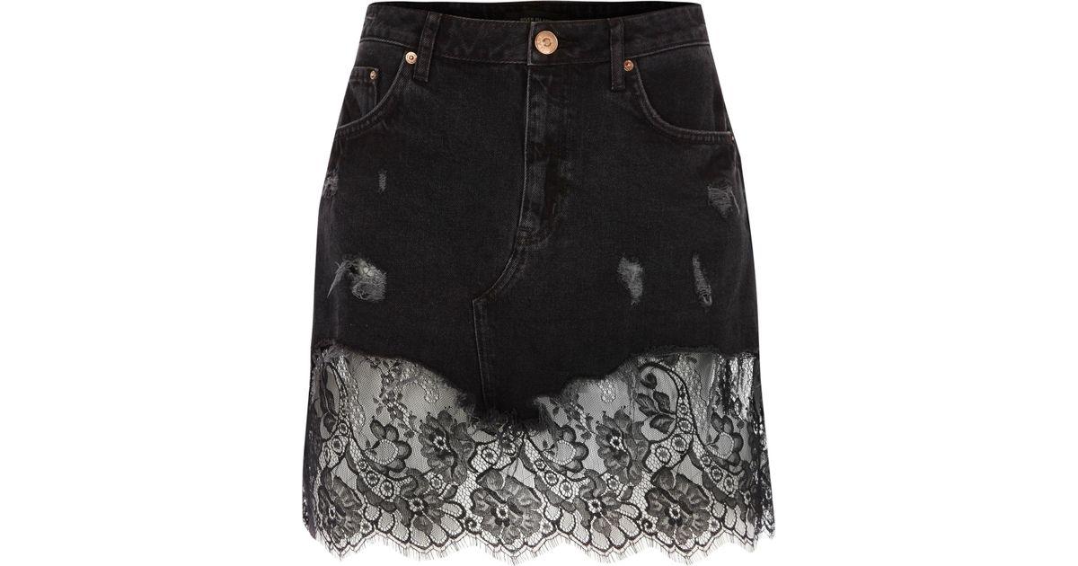 f3aa51db6b River Island Black Ripped Lace Hem Denim Skirt in Black - Lyst
