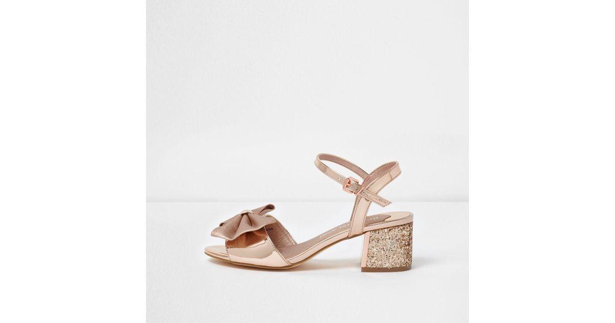892da72c328 Lyst - River Island Gold Bow Wide Fit Glitter Block Heel Sandals in Metallic