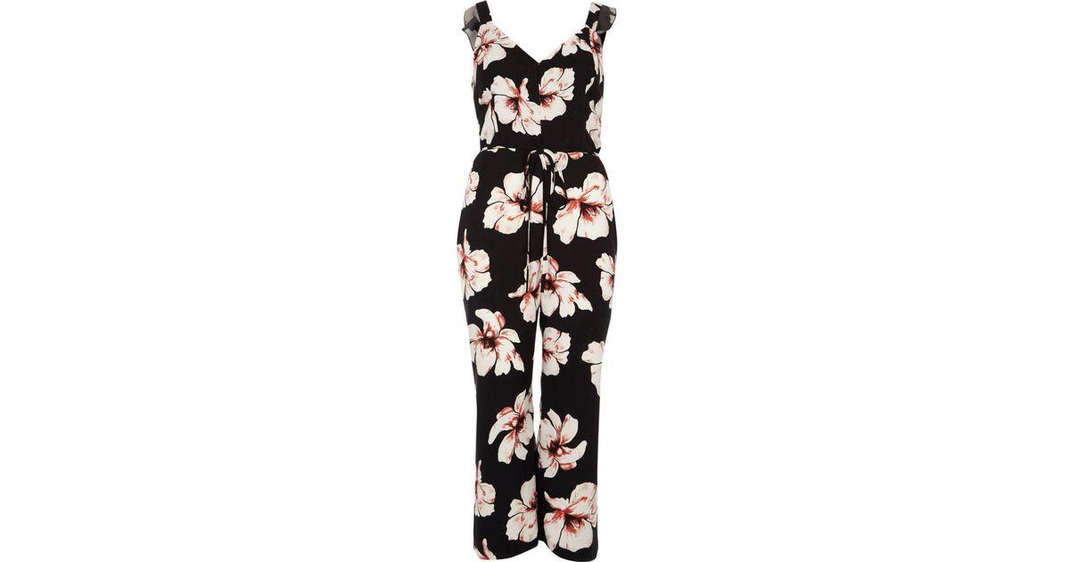 f1b72a4a30c Lyst - River Island Black Floral Print Culotte Tie Waist Jumpsuit in Black