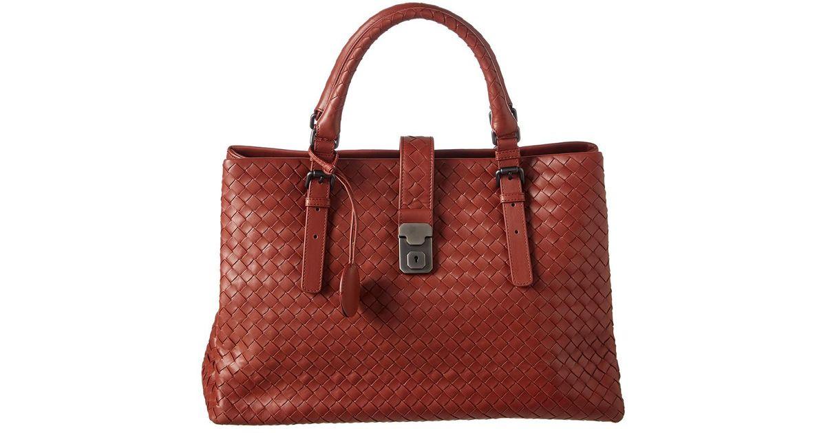 ac6621514884 Lyst - Bottega Veneta Medium Roma Prusse Intrecciato Leather Tote in Red
