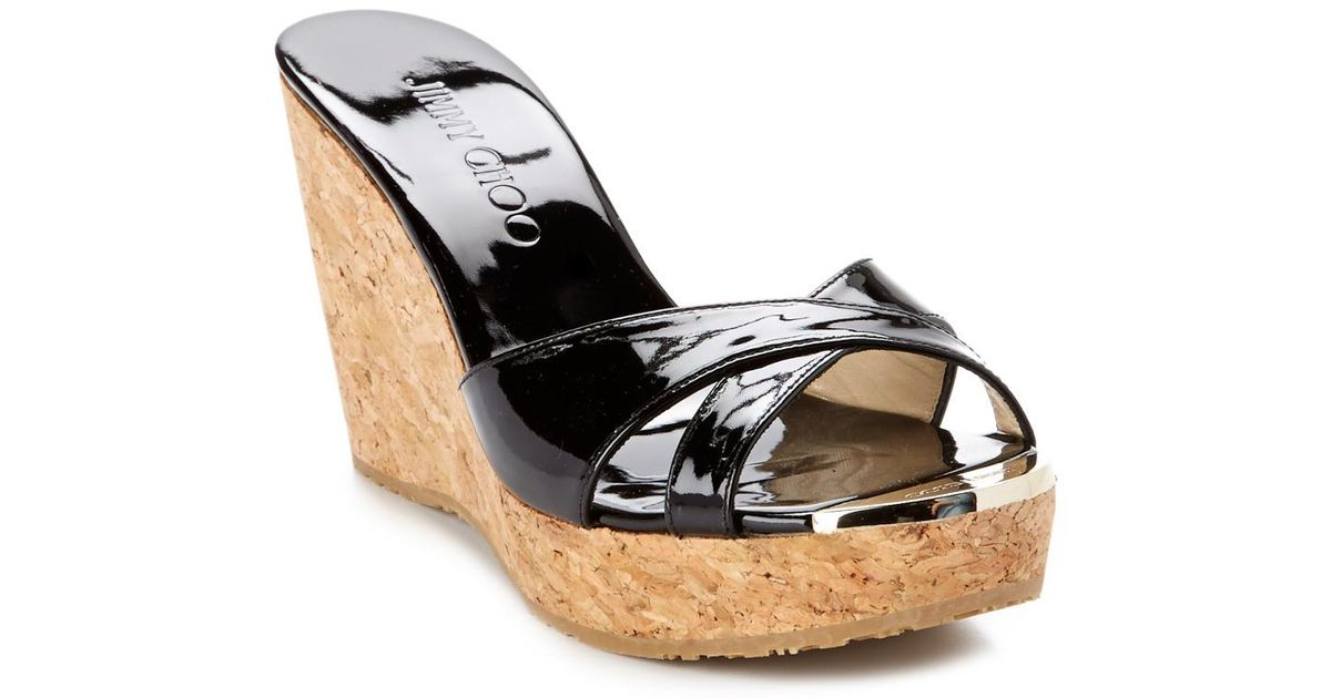 b6a9be267ba0 Lyst - Jimmy Choo Pandora Patent Wedge Sandal in Black