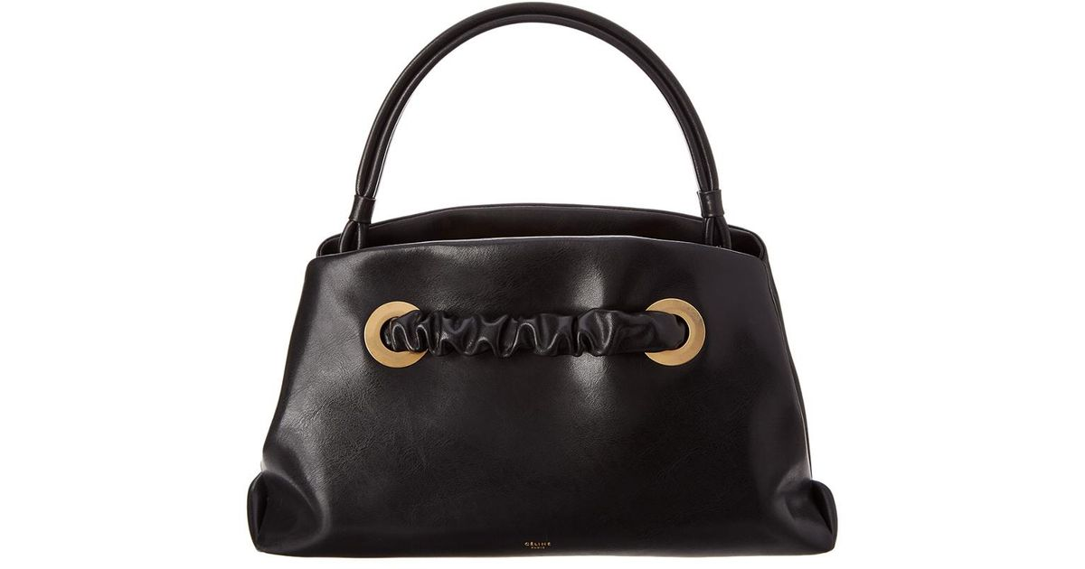 Lyst - Céline Céline Small Eyelets Leather Shoulder Bag in Black 577d8ff7b080f