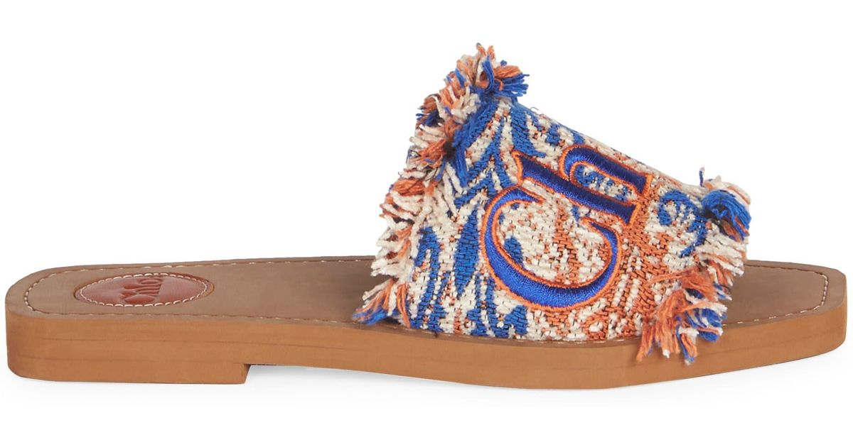 6647b7e9f Chloé Woody Flat Fringed Slide Sandals in Blue - Save 15% - Lyst
