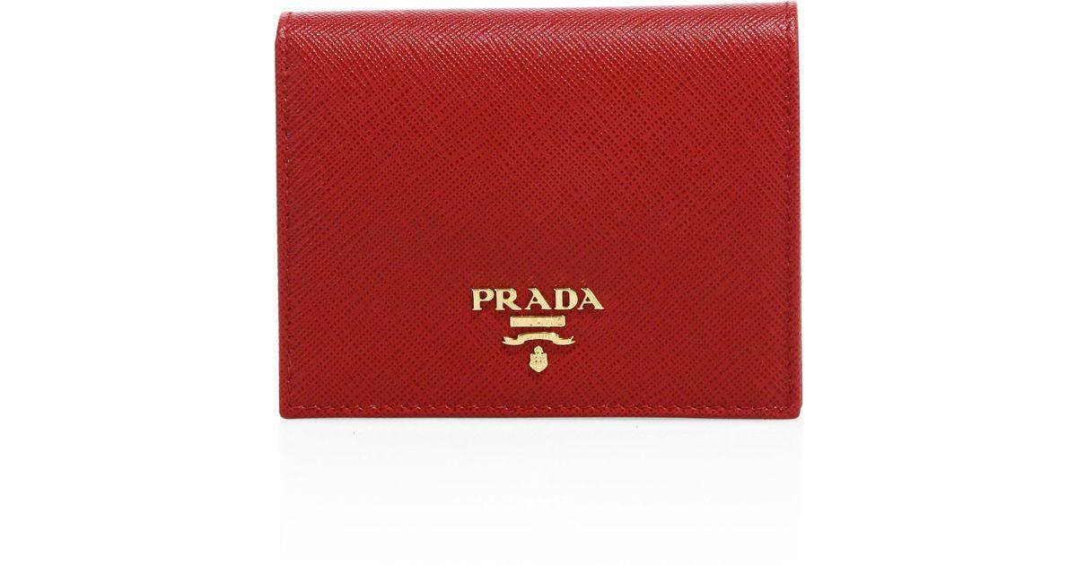 fecb772ddd26 ... new zealand lyst prada mini saffiano leather bifold wallet in red 1f3cd  5703c