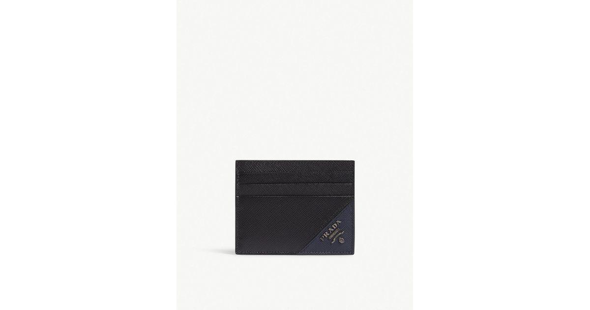 34435a108a1 ... czech lyst prada black saffiano leather card holder in black for men  06213 ba4d8