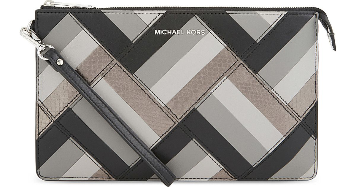 1cff0d7c454f Lyst - MICHAEL Michael Kors Daniela Marquetry Large Leather Pouch in Black