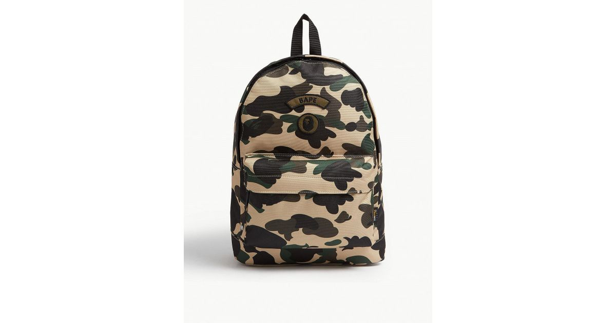 Lyst - A Bathing Ape Logo Camouflage Canvas Backpack in Yellow for Men f3c4f68bc2e84