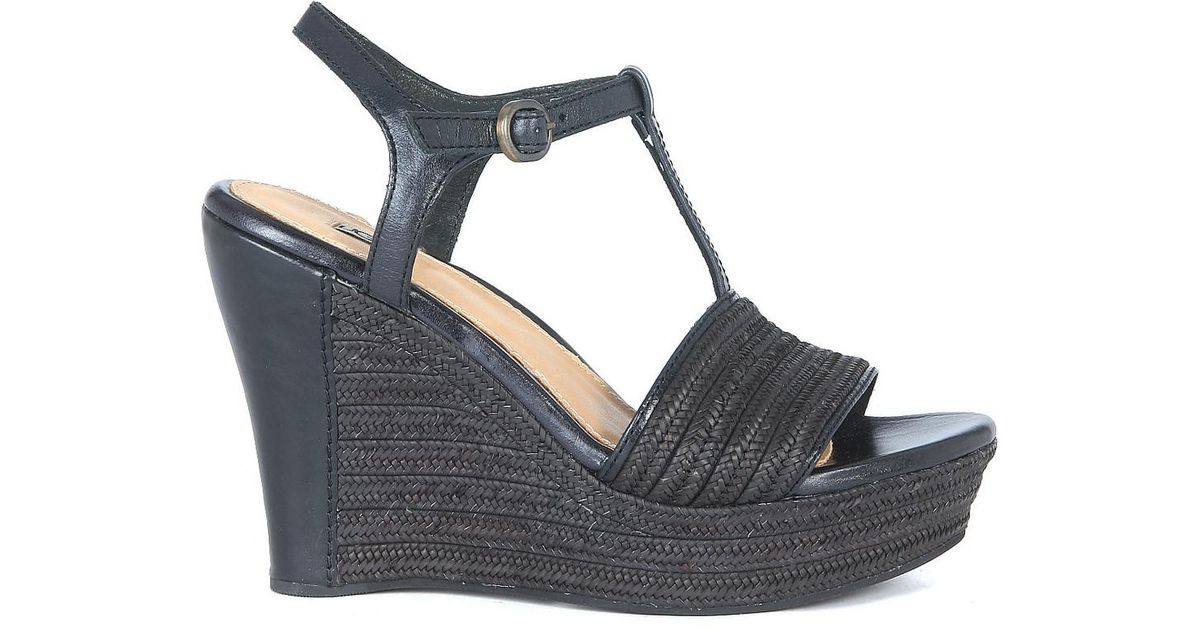 8f199cf73fe Ugg - Fitchie Wedge Sandal In Black Leather And Rafia Women's Sandals In  Black - Lyst