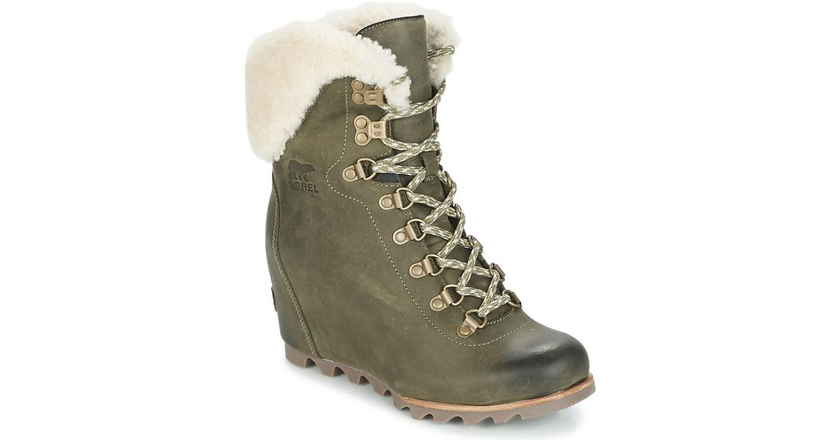 9871cfbf82f3 sale retailer 9a8ab cf6a4 Lyst - Sorel Conquest Wedge Holiday Booties   wholesale dealer b4d7f 817c5 Sorel Conquest Wedge Shearling Womens Snow  Boots In ...