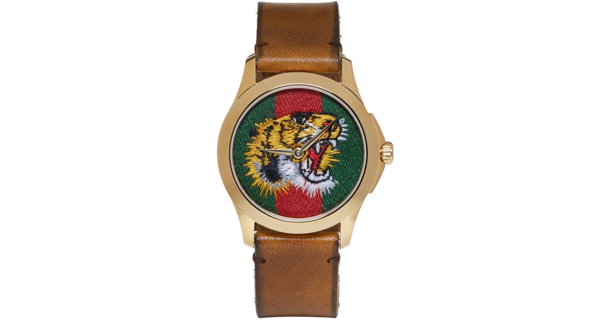 lyst gucci gold medium g timeless tiger watch in metallic