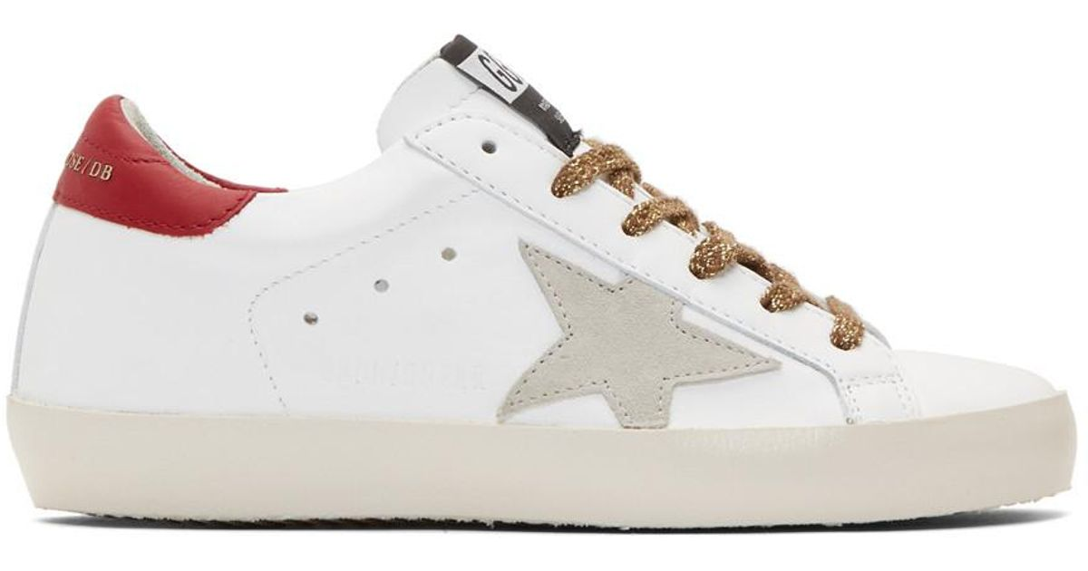 01b1f2d2fea Lyst - Golden Goose Deluxe Brand White And Gold Lettering Superstar Sneakers  in White