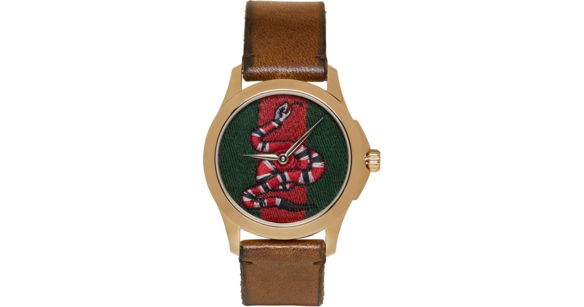 lyst gucci gold medium g timeless snake watch in metallic for men