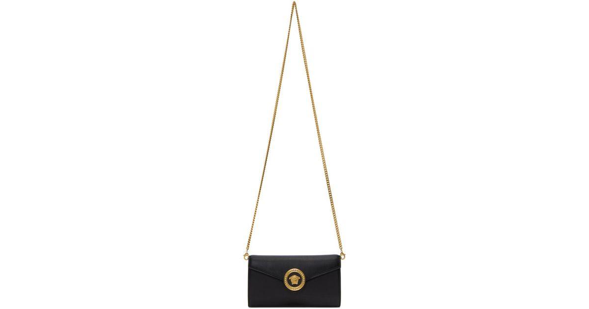5849ba584c53 Lyst - Versace Black Medusa Tribute Wallet Chain Bag in Black