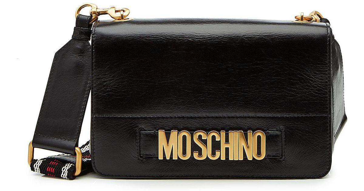 ad2b837945 Moschino Logo Embellished Patent Leather Shoulder Bag in Black - Lyst