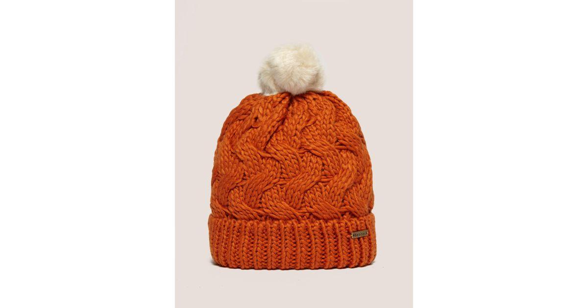 2bccf5418ea Barbour Fur Pom Hat in Orange - Lyst