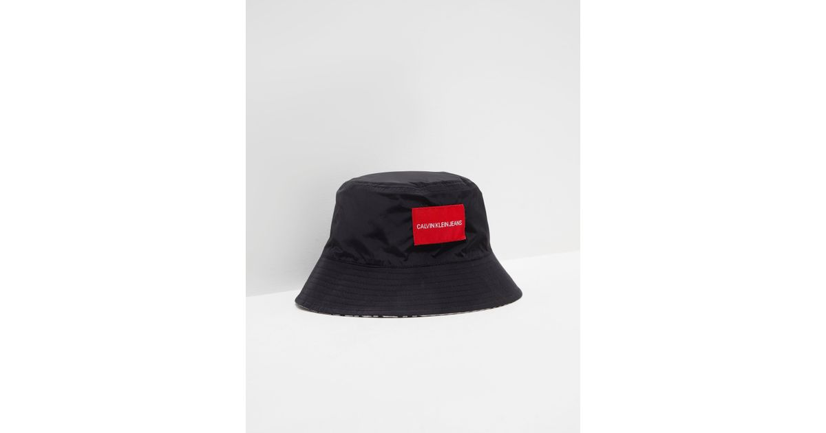 7cdd78343cc5a Calvin Klein Womens Reversible Bucket Hat - Online Exclusive Black in Black  - Lyst