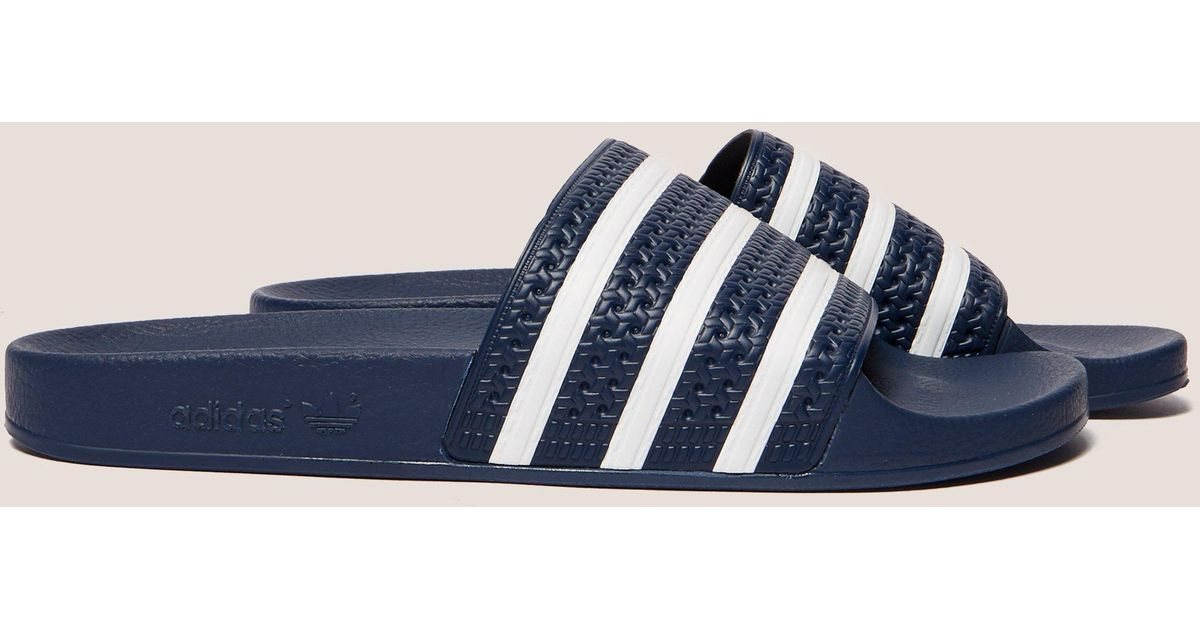 premium selection 10b09 f1d6c Lyst - adidas Originals Mens Adilette Slides Navywhite, Navywhite in Blue  for Men