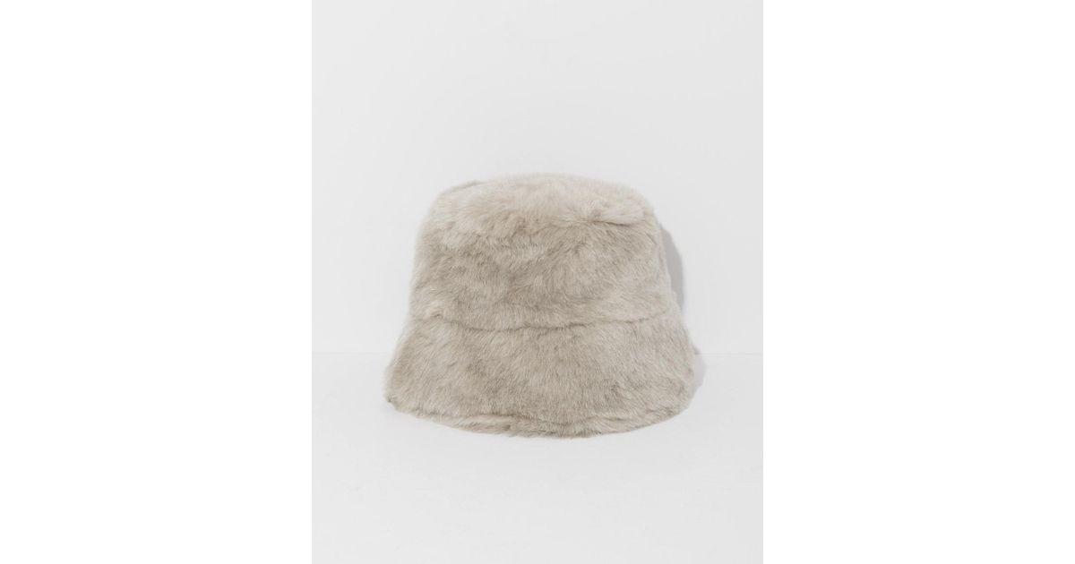 955c859be6a Lyst - Clyde Ecru Fur Bucket Hat