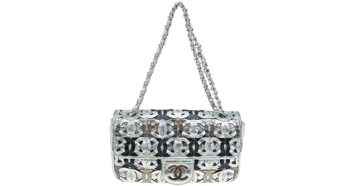 4ca51ad5205617 Chanel Silver Leather Cc Cutout Flap Handbag in Metallic - Lyst