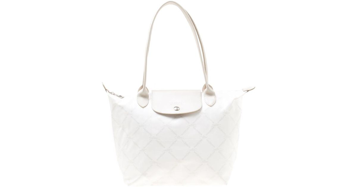 5022f488769 Longchamp White/light Gold Logo Printed Coated Canvas Le Pliage Tote in  White - Lyst