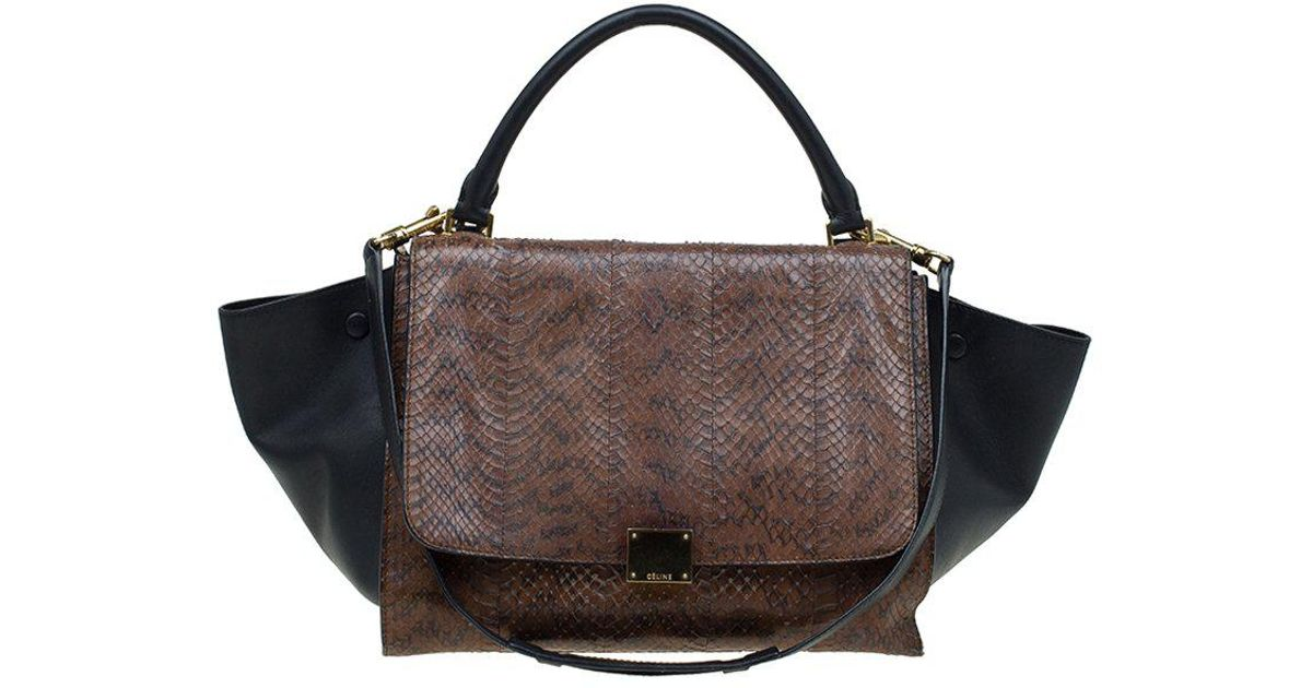 597ac094a679 Lyst - Céline Python Leather Medium Trapeze Bag in Brown
